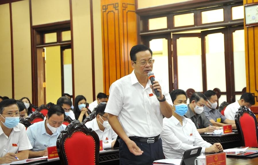 Chủ tịch UBND tỉnh Nguyễn Văn Sơn phát biểu làm rõ một số nội dung đại biểu quan tâm.
